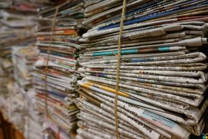 Newspapers stacked