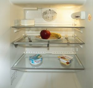 Remove all the food and shelves from refrigerator to prepare it for the move