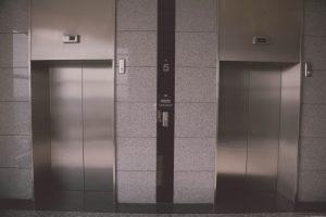 Two metal elevator doors