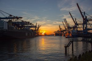 Sea port at sunset used for Kuwait exports