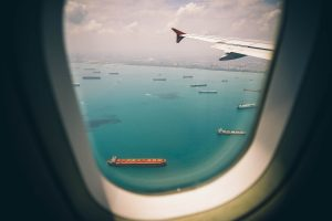 Transport ships seen from airplane while moving to Doha