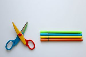 scissors and markers on table