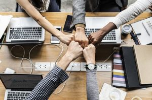 Try to be a good team member if you want to adapt at new workplace