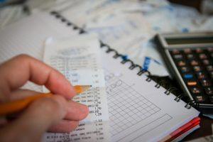 Person calculating his shipping bills.