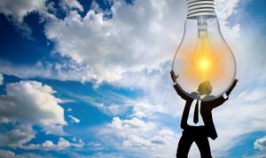Man is holding light bulb.