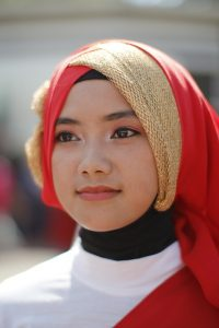 A woman with a hijab.