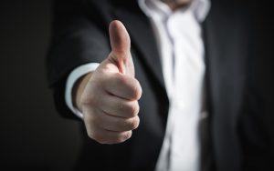 Thumbs up gesture.