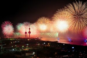 Kuwait at night with fireworks in the sky
