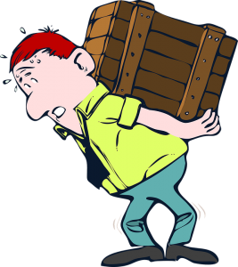 A man carrying a heavy box on its back