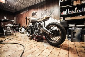 A motorcycle in a garage after transportation.