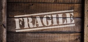 A wooden box that says fragile