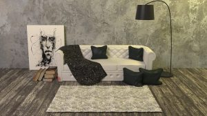 A white couch with black pillows.