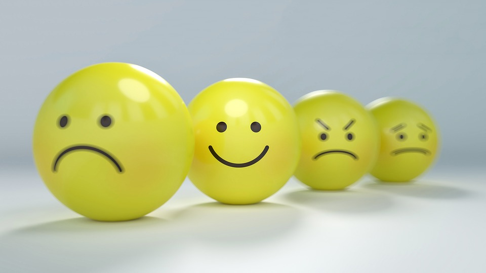 Four yellow emoticons with different faces.