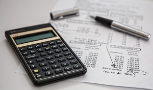 Insurance policy and a calculator