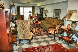 A living room with a rug in the middle.