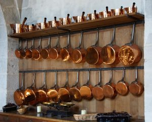 Pots hanging on the kitchen wall.
