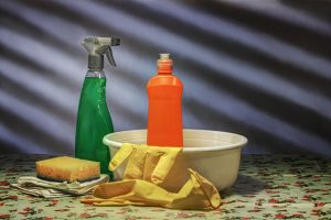 Gloves, sponge, and cleaning products.