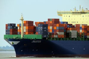 A cargo ship loaded with containers.