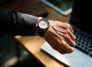 A man looking at the watch - don't stress over movers being late