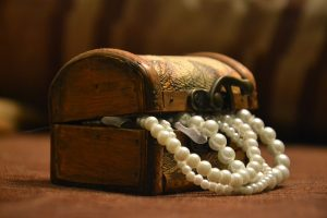 Wooden jewelry box with a pearl necklace