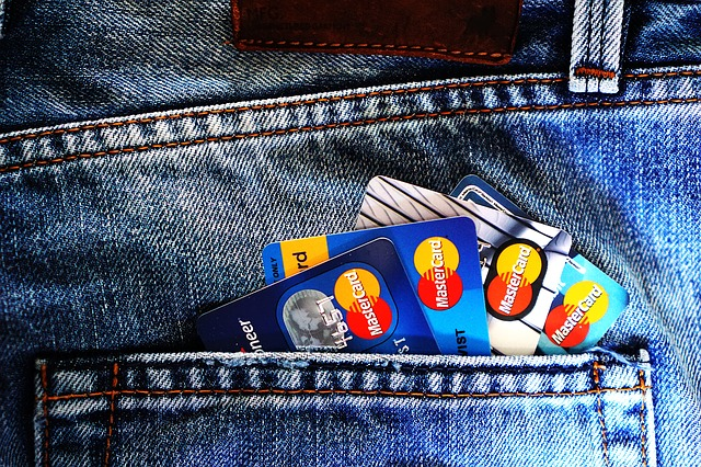 Credit cards in back pocket. Who to notify when you move? Your bank and credit card issuer.