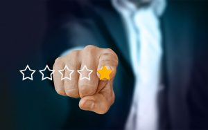 Man clicking on one out of five stars - different reviews will help you compare residential movers