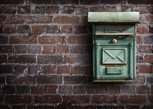 Mailbox on a wall. Notify your post office when you move.