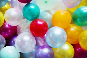 Colorful balloons - throwing a party is a good way of meeting new neighbours after the move.