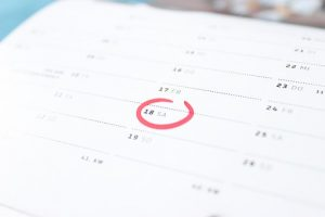calendar with the number 18 circled in red
