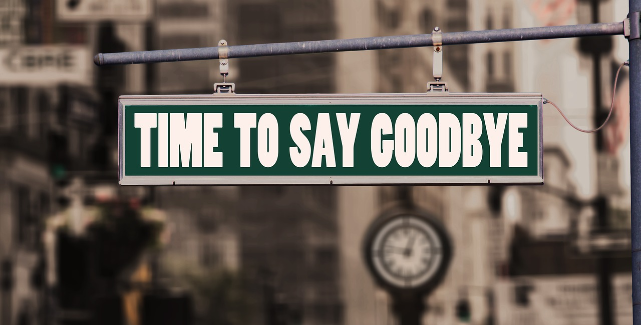 ''Time to say goodbye'' sign. Here are ways to say goodbye to your friends when moving long distance.