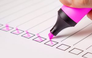 A checklist and a pink highlighter