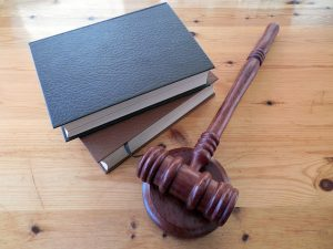 Books of law and a judge's hammer
