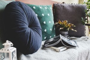 Books on a couch. Reading in a comfy spot is a great way of post-move relaxation