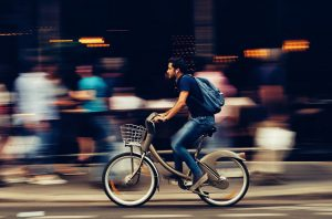 a man on a bike - pack your home in a day