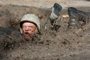 Man falling in mud