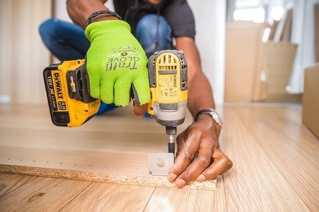 using power tool to prepare your furniture for moving to Kuwait
