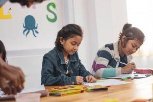 Two girls doing school work.