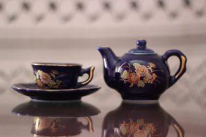 A tea cup and pot