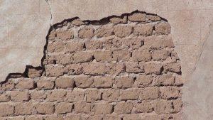 Damaged wall showing bricks