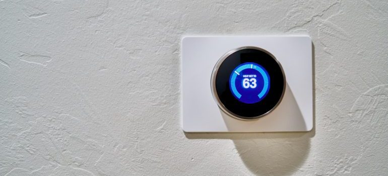 thermostat showing 63 degrees Fahrenheit