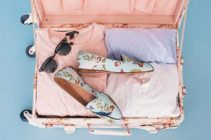 clothes in pink luggage