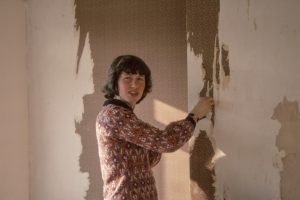 A girl paint walls