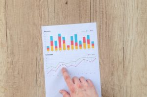 Hand pointing to a graph chart