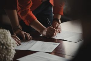 person signing paperwork