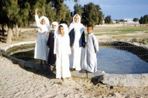 children in Kuwait waving