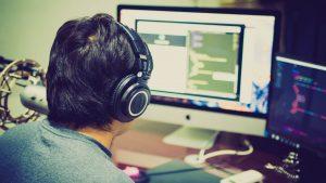A man facing the computer