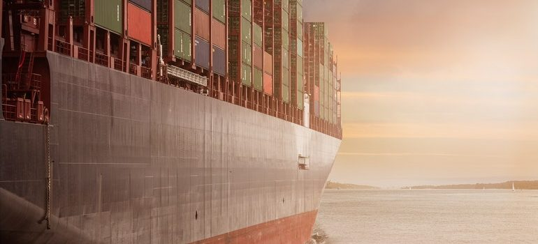 A ship loaded with containers shipping a vehicle overseas