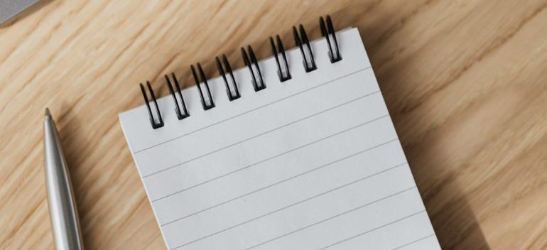 a notepad and a pen