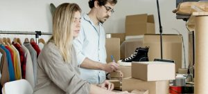 a couple calculating final cost of your relocation from Kuwait to Dubai