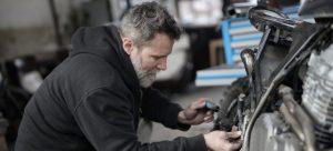 Man fixing his motorcycle